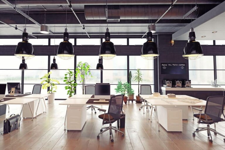 digital marketing office with wooden floors, white tables and black chairs